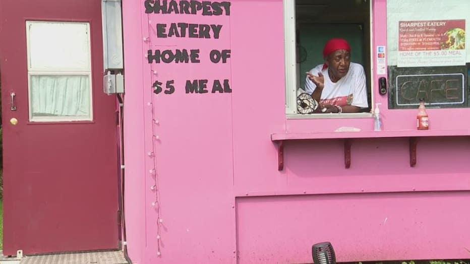Doris Sharpe-Frasier and her Sharpest Eatery stand in her front yard.