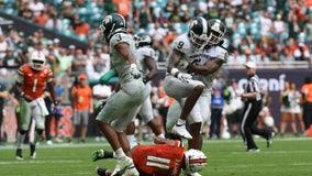 Spartans run: Michigan State rolls past No. 24 Miami, 38-17
