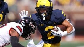 Corum's 3 TDs help No. 25 Michigan rout N. Illinois 63-10