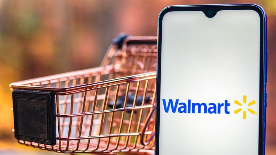 In this photo illustration, a Walmart logo seen displayed on