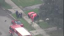 One killed in Detroit crash as stolen car hits pole, gets split in half