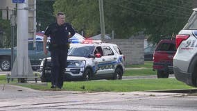 2 employees shot outside auto sales business in Clinton Twp; search continues for gunman