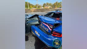 Driver slams into Michigan State Police patrol car while trooper works to remove abandoned vehicle from road