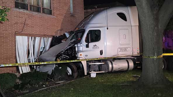 Semi-truck driver flees crash after striking five parked cars, running into Detroit apartment