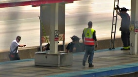 Woman hit, killed by Red Line train while trying to get phone she dropped on tracks