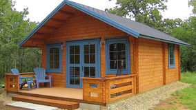 You can buy a log cabin-style tiny house for less than $20K on Amazon