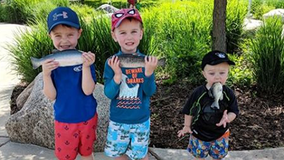 Mom photographs candid moment with sons, doesn't realize one has fish stuck in his mouth