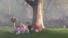 Home where toddler found dead under couch burns to ground