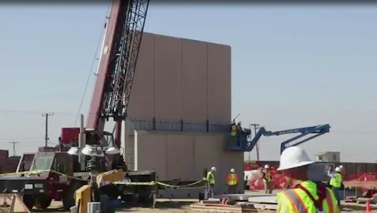 One of the prototype border walls being built in San Diego.