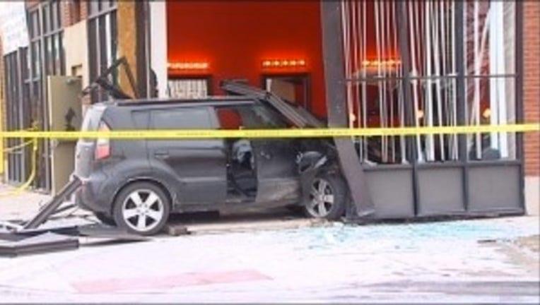 00cd90ee-SUV crashes into barbershop