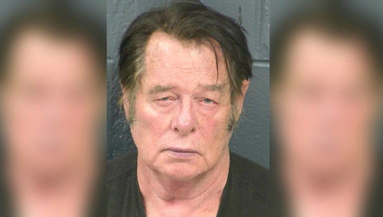 14f732d6-Larry Mitchell Hopkins was arrested on felony weapons charges after his group started detaining immigrants at the border