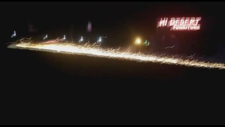 Police chase ends with sparks flying from suspect's rims