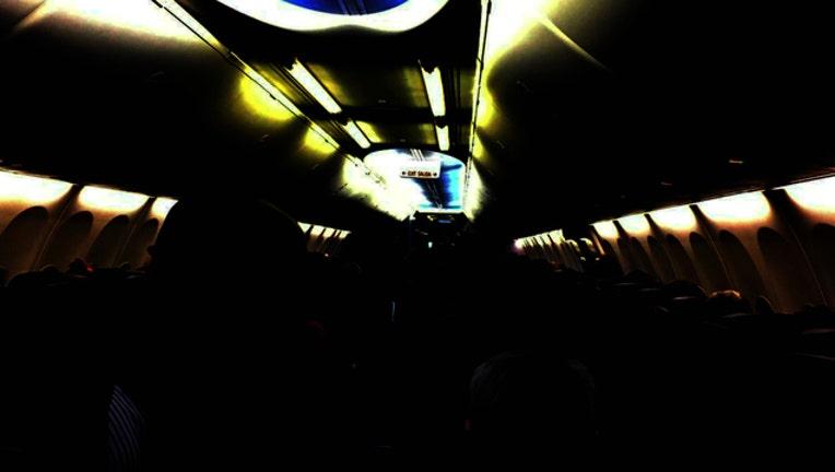 265a43ad-Empty dark plane_1561322823348.jpg.jpg
