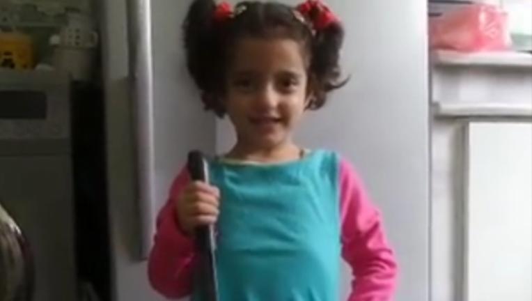 3322647c-memri-girl-knife-video_1445556205787.png