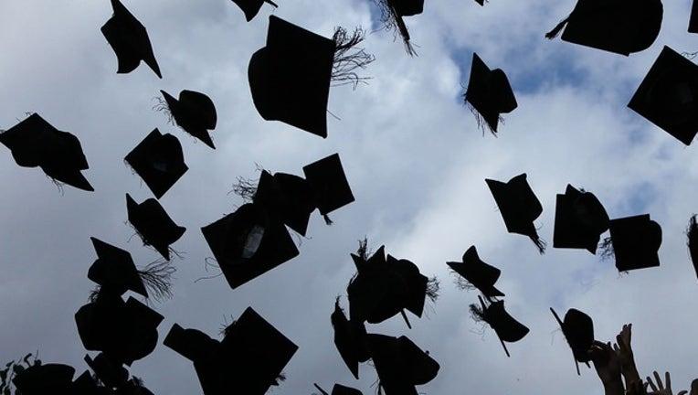 398b3e7c-GETTY graduation hats_1552759682714.png-402429.jpg