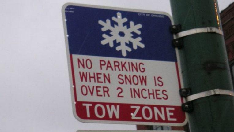 3c8363b6-chicago winter parking tow sign_1480123582540.jpg