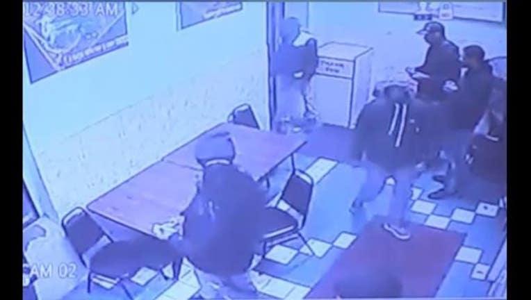 4a6ce53b-Surveillance image of a shooting inside a Little Village restaurant