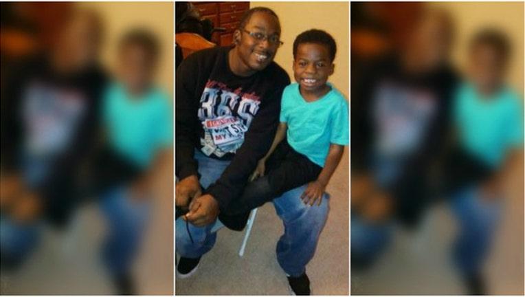 4babdbc7-Tyrone Hardin and his 5 year old son