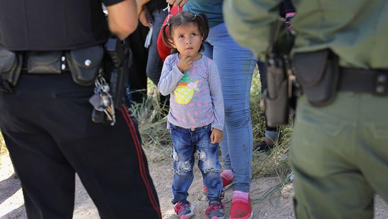 4c0a4a56-GETTY-migrant-children-Border-Patrol_1556311235658-407068.jpg
