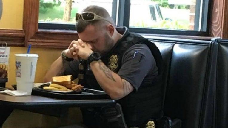 officer prays_1535634267835.jpg-404959.jpg