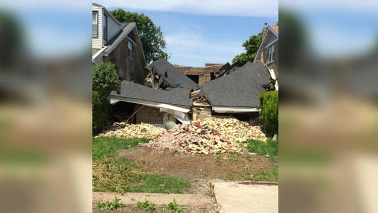 509ffe6a-collapsed-house-final_1465676512880.jpg