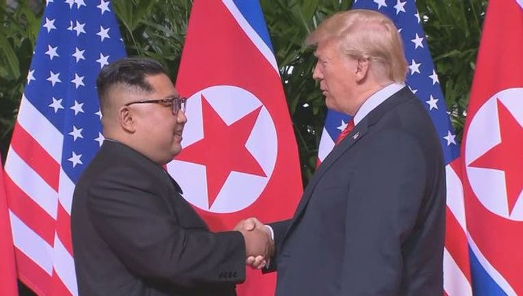 57b65810-Trump Kim Jong Un Shake Hands 2-401720-401720.jpg