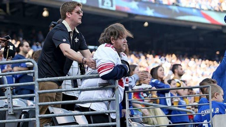 5bc5d784-LA-Saints-Fan-Helps-Giants-Fan_1538653227019-408200.jpg