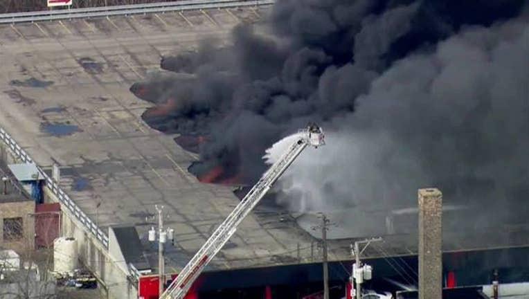 5d30659a-Firefighters_battling_2_alarm_fire_in_We_0_20160308163603