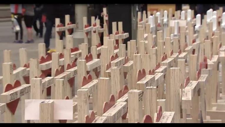 5daf7e1f-Crosses on Michigan Avenue to honor victims of violence