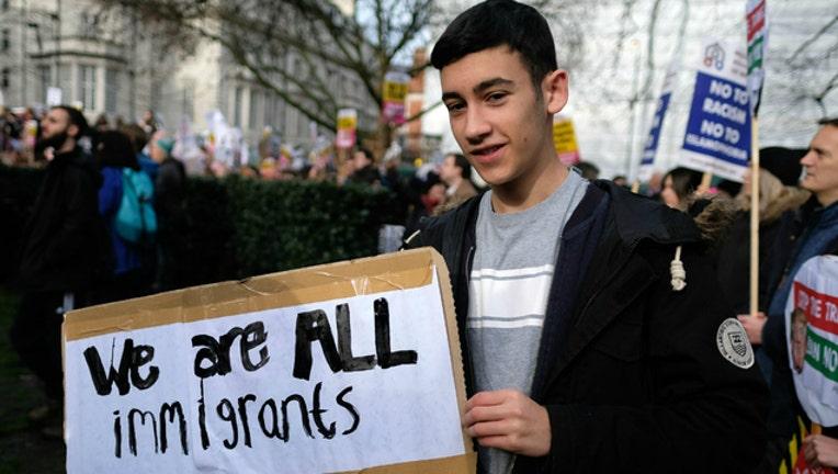 immigrants-immigration_1496771548944.jpg