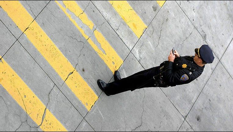 657a960a-cop-police-phone.jpg