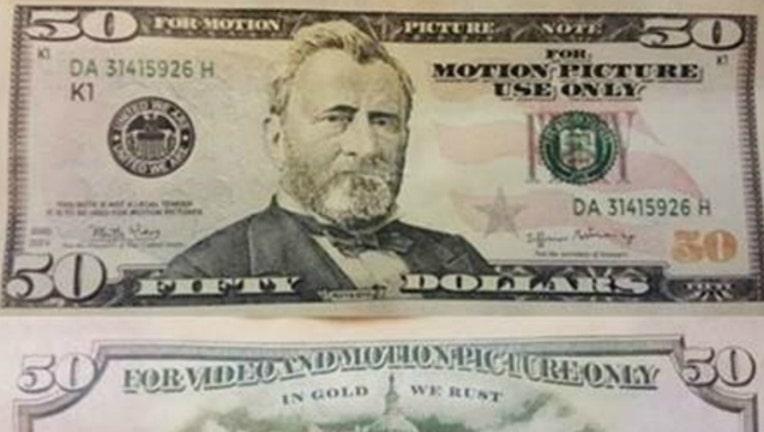 6f144cbd-fake money_1510628899497.jpg