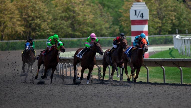 75d1f5b1-race-horses-track_1462147809099.jpg