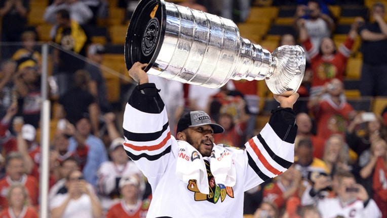 GETTY NHL Goalie Ray Emery raises the Stanley Cup for the Chicago Blackhawks in 2013.