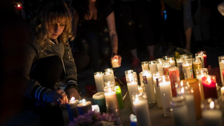 7daaa1cb-GETTY-Las-Vegas-victims-memorial-tribute_1507039102471.png