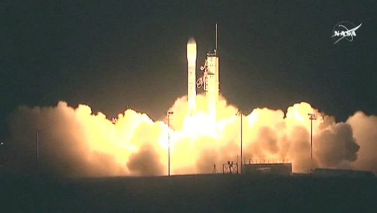80e4315c-NASA launches a rocket with a weather satellite