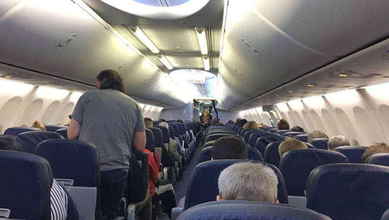 Passengers stuck on a United Airlines flight during a ground stop because of computer problems (Photo - Kelly O'Bray)