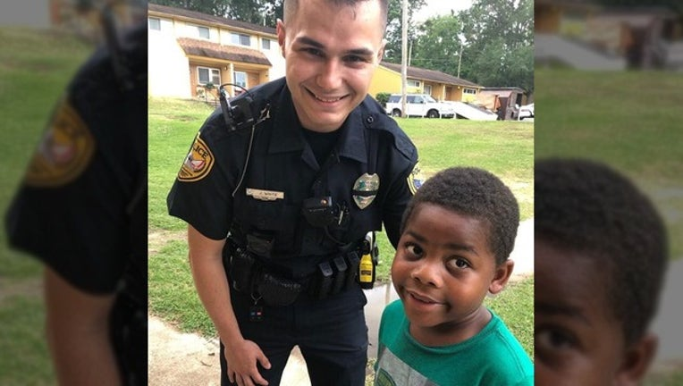 8b002f44-CITY OF TALLAHASSEE PD_kid and officer_050819_1557328947996.png-402429.jpg
