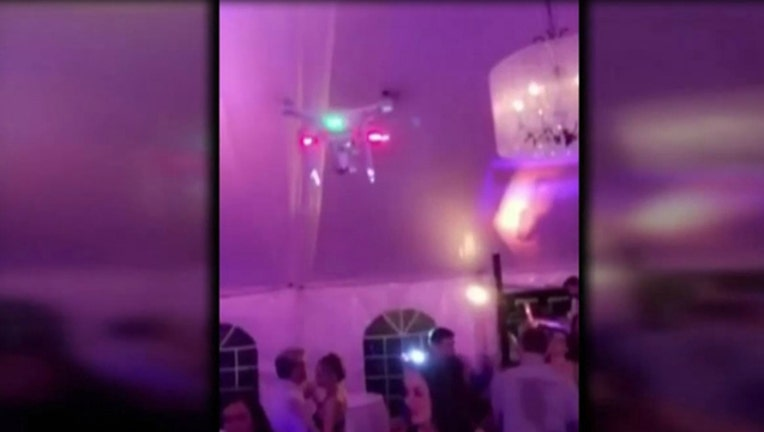 8b2f82e4-Wedding guests sue groom over drone accident at reception