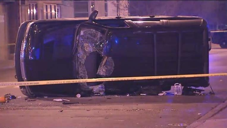8ed5740a-A child was killed when an SUV ran a red light and crashed into a CTA bus, police said