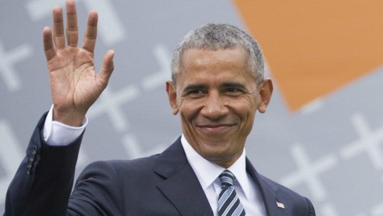 GETTY obama smile smirk wave_1526597067458.jpg.jpg