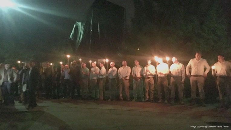 9ae1b252-Neo-Nazis marched in Charlottesville, Virginia on Saturday night.
