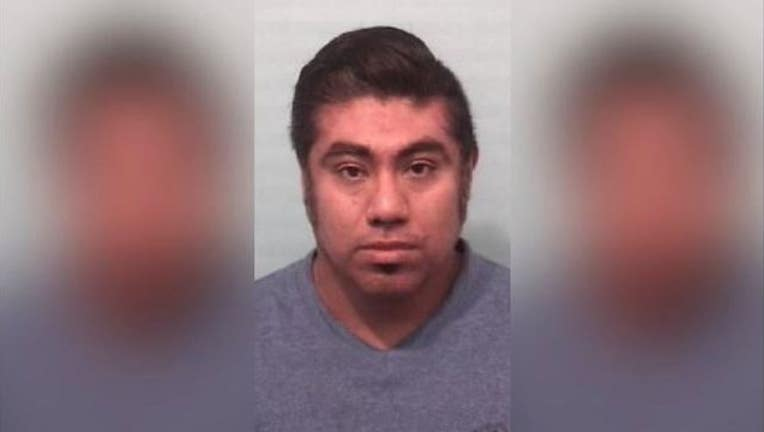 a6ed8f7a-Daniel Martinez of Naperville is accused of secretly recording women shoppers