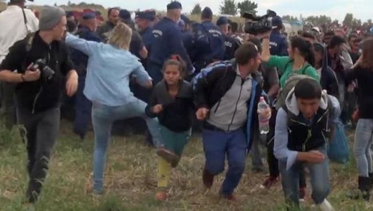 ac539240-Hungary Migrants Reporter-1_1441840996283.jpg