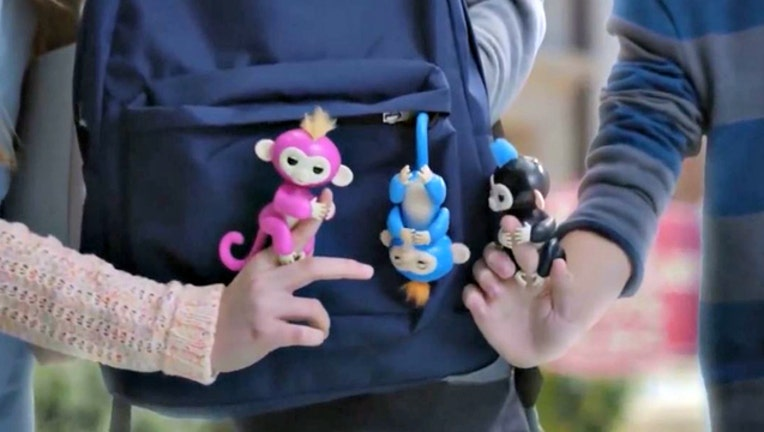 bed499c1-This is a still image of real Fingerlings from a Fingerlings ad.