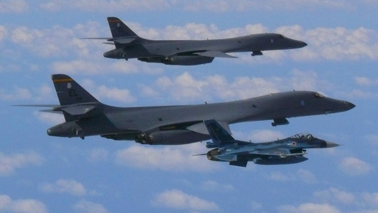 US Air Force and Japan Air Self-Defense force over East China Sea before going to Seoul, South Korea