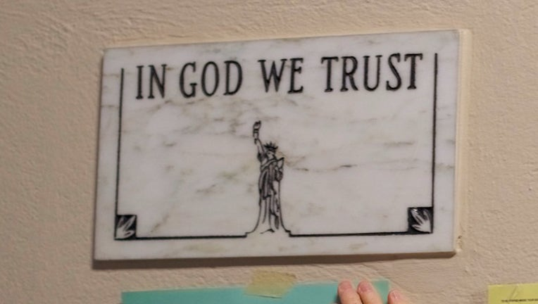 IN GOD WE TRUST GETTY_1533828637323.jpg-403440-403440.jpg