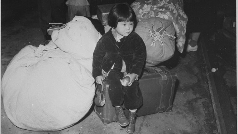 d4c8b8b9-A girl of Japanese ancestry is moved to an internment camp during World War 2.