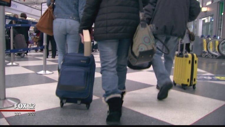 Travelers stranded at O'Hare because of flight cancelations caused by snow storm