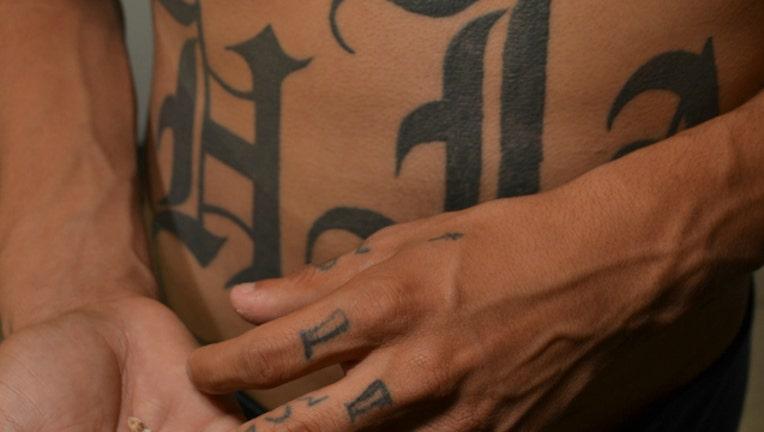 e8768529-tattoos-gangs_1490108661574.jpg